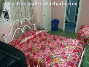 Air-conditioned room with two beds and TV