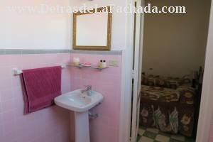 Bathroom with shower stall and booster pump