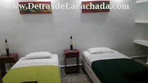 Habitación con dos camas personales
