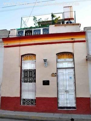 Calle Máximo Gómez #208 e/ Berenguer y e. Yanes Reparto el Carmen